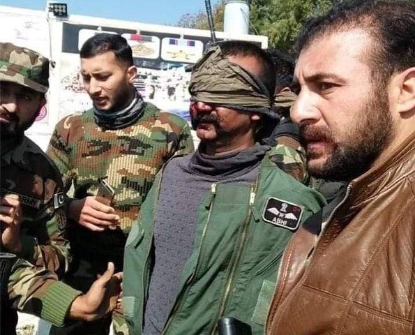 After his capture, Wing Commander Abhinandan Varthaman being escorted to a military facility | APP