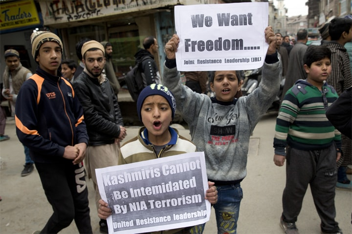 Kashmiri children hold placards and shout freedom slogans in Srinagar: the root cause of Indo-Pak tensions is ignored by India | AP