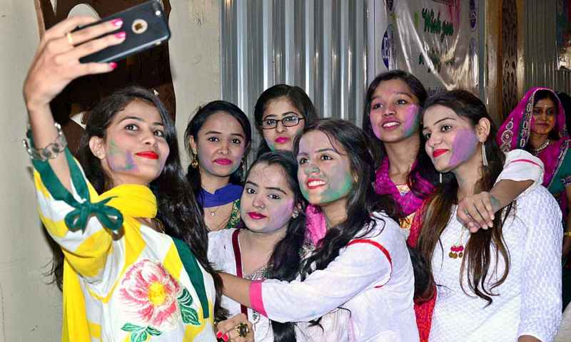 A group of girls from the Hindu community in Hyderabad, Pakistan, celebrating the festival of colors gather together for a selfie on March 20, 2019. — APP