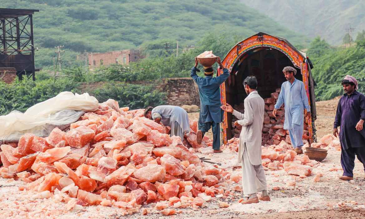 Labourers load a truck with salt rocks in Khewra.