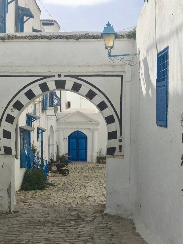 A French baron is widely credited for the town's blue-and-white colour scheme.