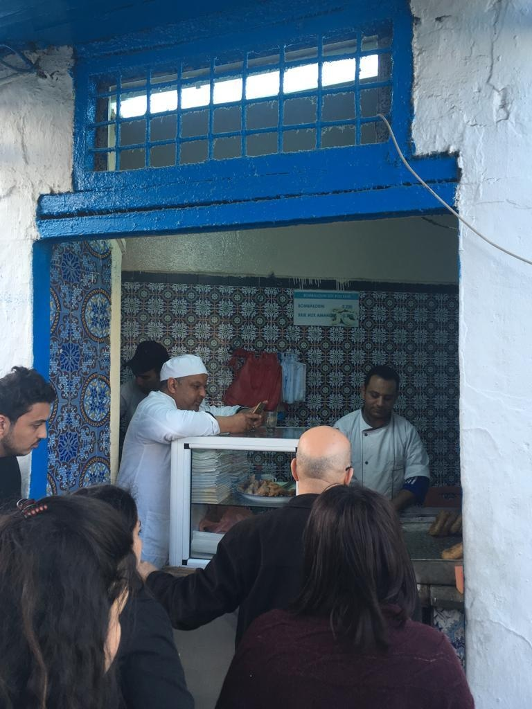 At any point during the day, you'll see a queue outside this window, looking into a kitchen, which sells deep fried, on-the-go desserts.