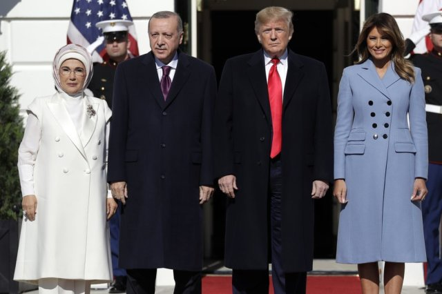 US President Donald Trump and first lady Melania Trump welcome Turkish President Recep Tayyip Erdogan and his wife Emine Erdogan to the White House on Wednesday. ─ AP