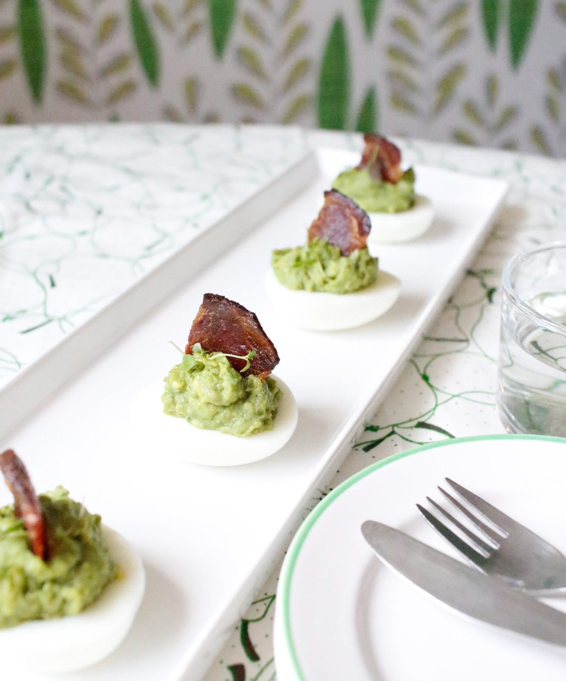 Keto avocado eggs with bacon sails