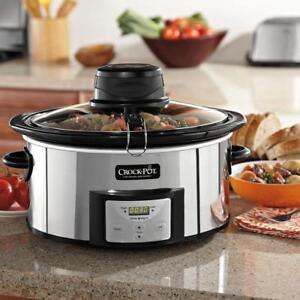 kitchen crocks black cabinets crock pot 6 5 quart programmable stirring home slow stock photo