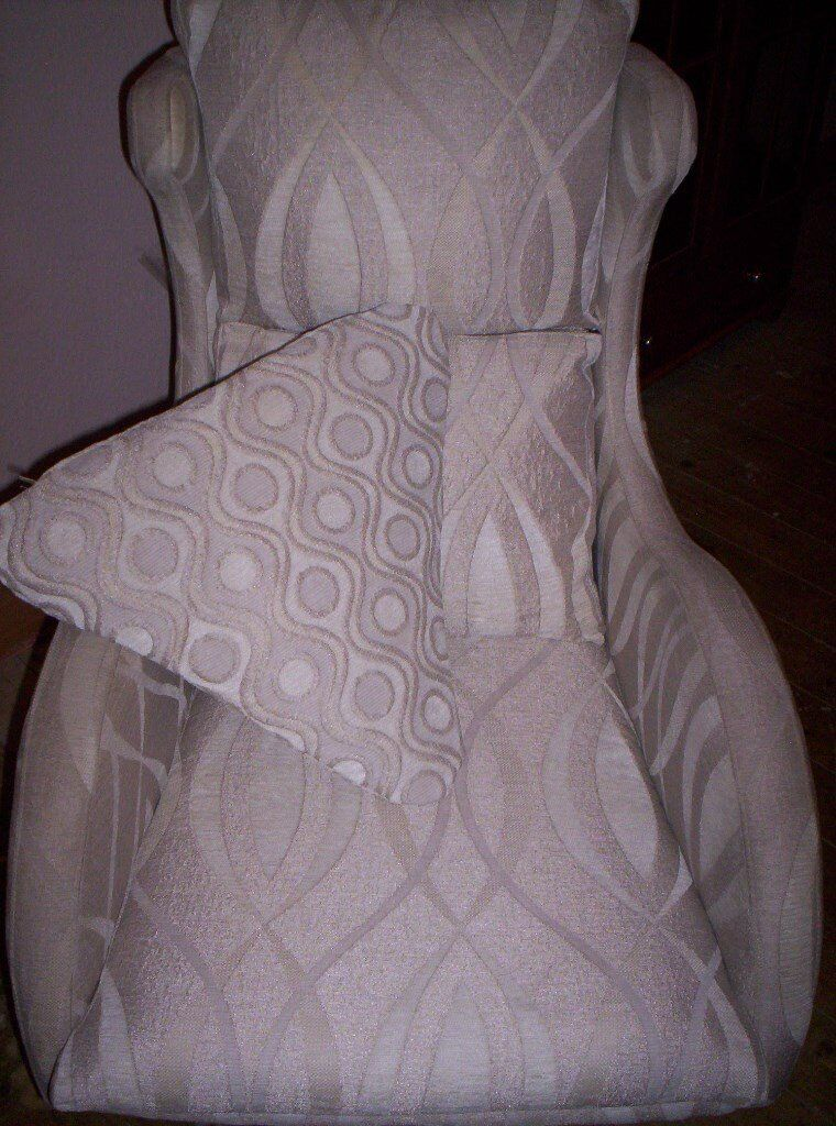 swivel chair in spanish quatropi hanging review designer curvy by furniture group fama cream and beige color