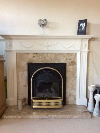 Black and gold gas fire. Various shades of cream marble ...