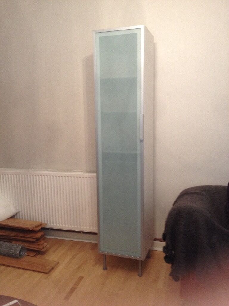 Ikea Tall Bathroom Storage Cabinet. White with opaque