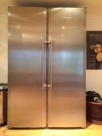 LIEBHERR STAINLESS STEEL TALL FRIDGE AND FREEZER STAND
