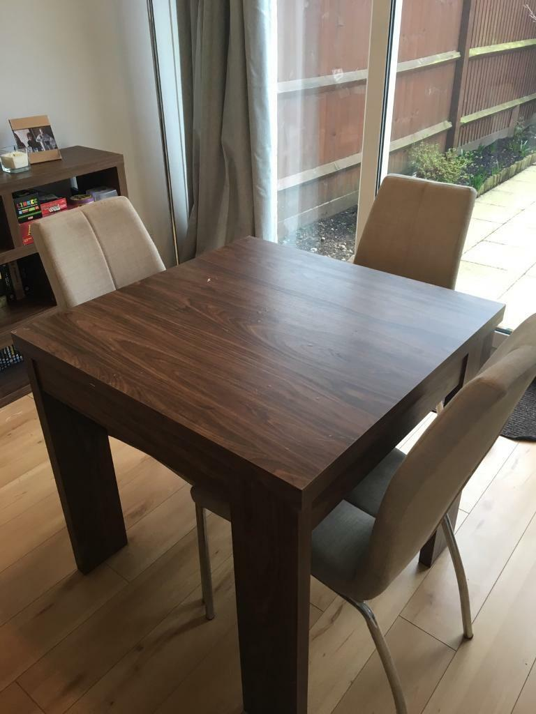 Next Extendable Dining room table with 3 chairs  in