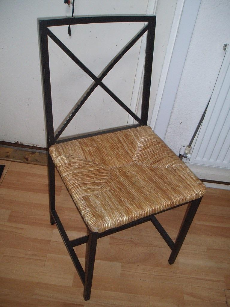 Solid but elegant metal frame chair with wickerraffia