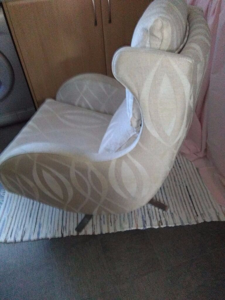 swivel chair in spanish high end office fama designer curvy upholstered cream and beige fabric with chrome legs
