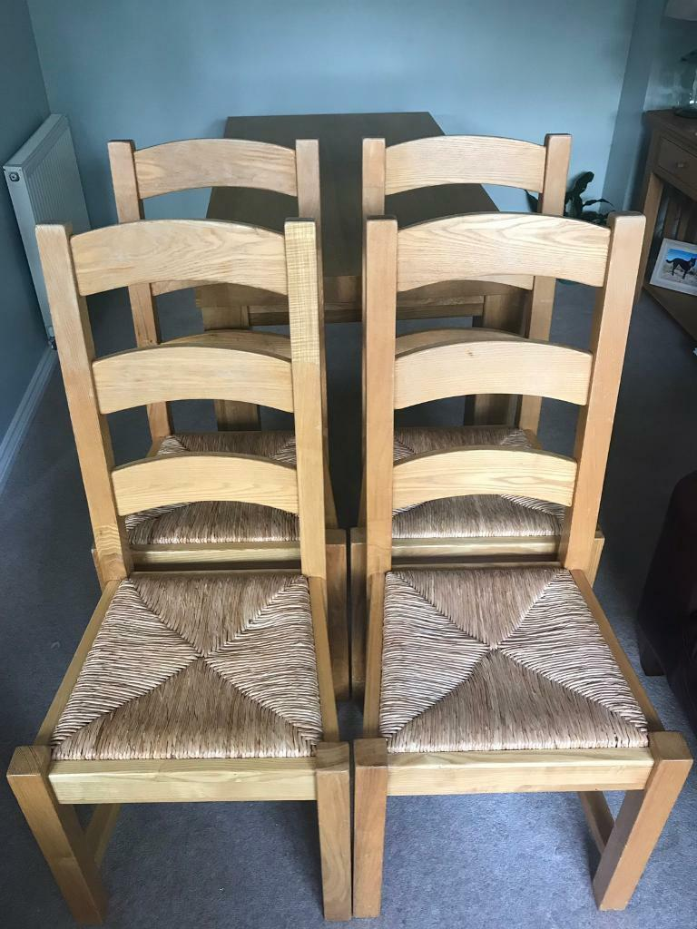 used kitchen chairs ninja mega system 1500 review four solid oak dining with wicker seat in