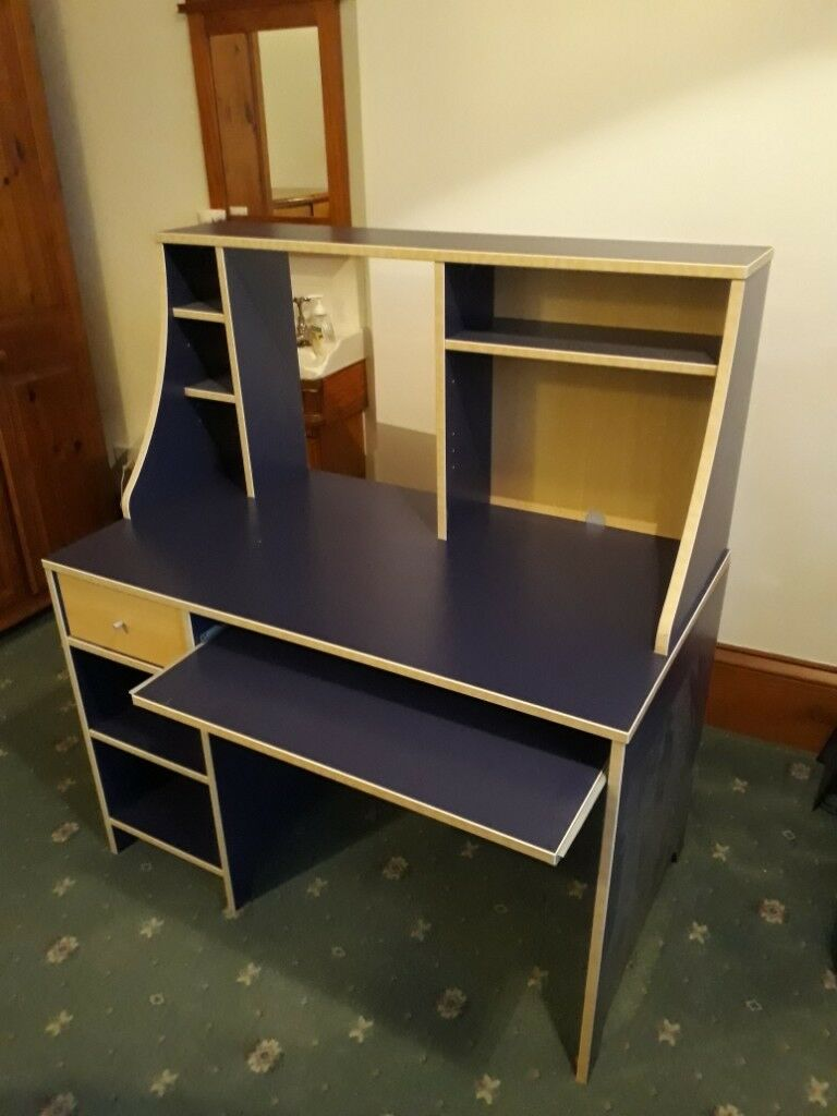 revolving chair used black plastic garden chairs a blue robin desk set from ikea including shelving unit and