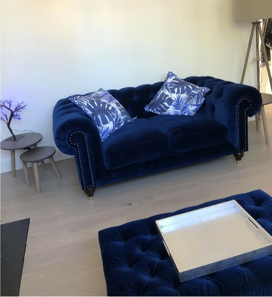 blue velvet chesterfield sofa black and gold table two seater electric matching ottoman from swoon