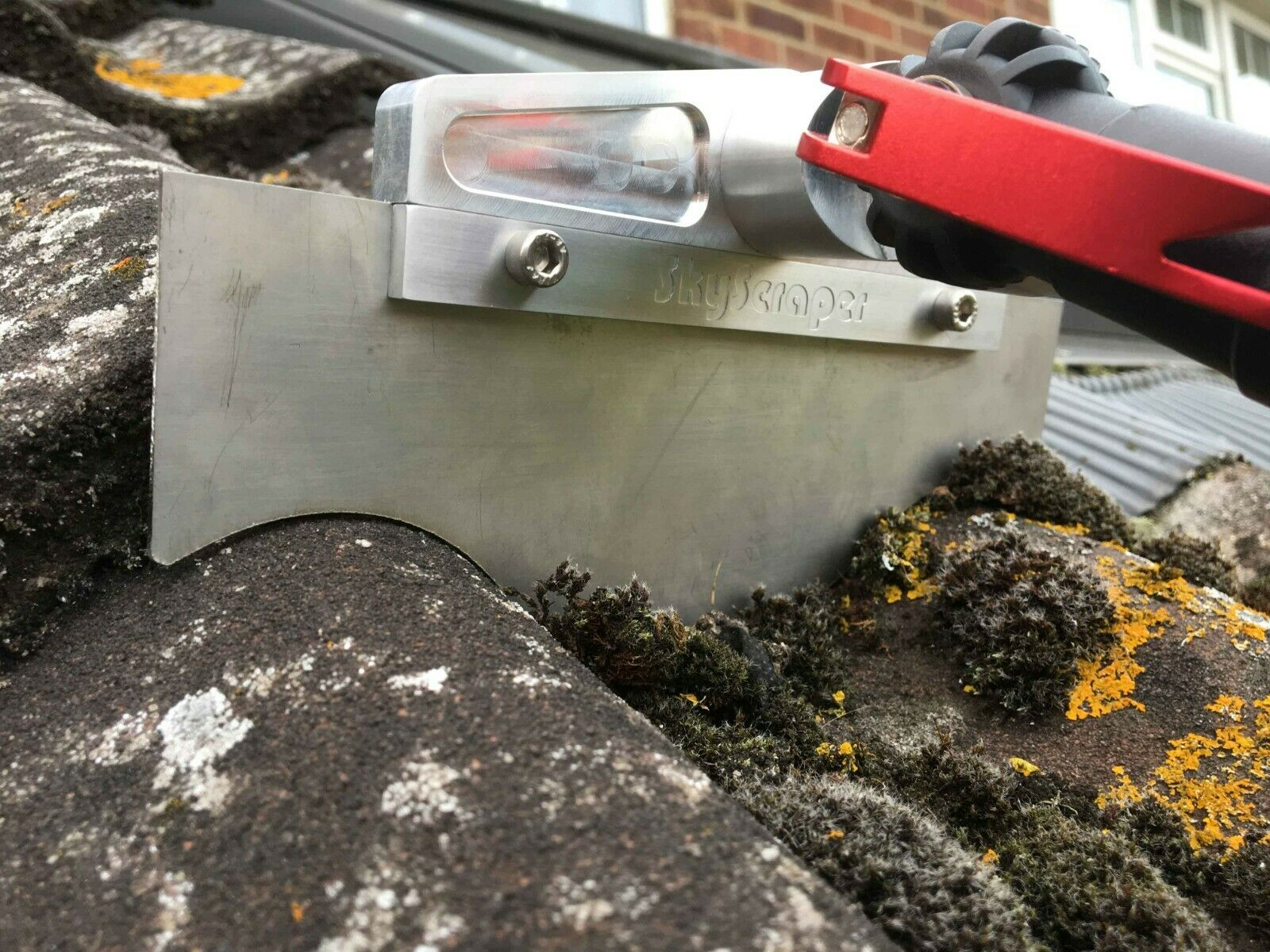 roof cleaning moss removal scraping