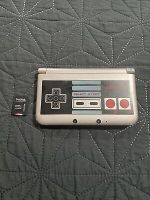 Nintendo 3DS XL Retro NES Edition + 64GB Memory Card