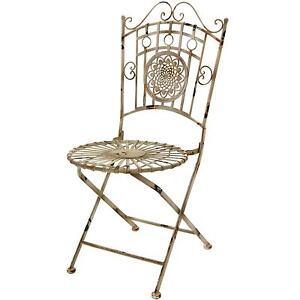 Antique metal lawn chair