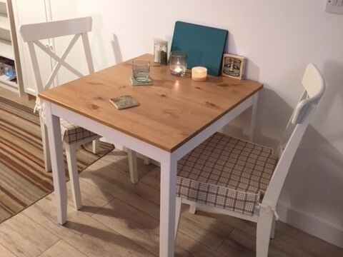 Wood Topped White Kitchen Dining Table And White Chairs