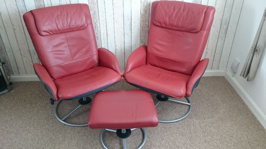 IKEA dark red leather swivel  reclining chairs with footstool  in Livingston West Lothian
