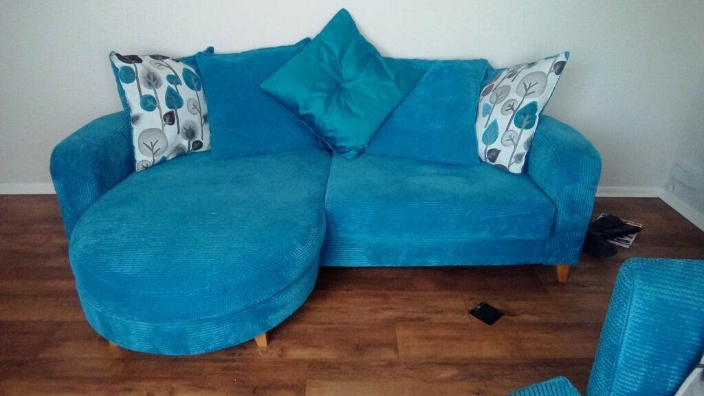 Teal blue DFS 4 seater sofa with matching swivel cuddle