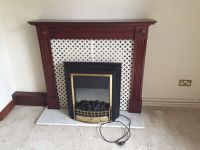 Electric fireplace heater & wood radiator surround on ...