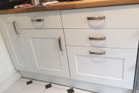 Gloss white kitchen cabinet doors with hinges and handles ...