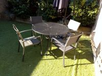 Metal garden table and four chairs with table hole for