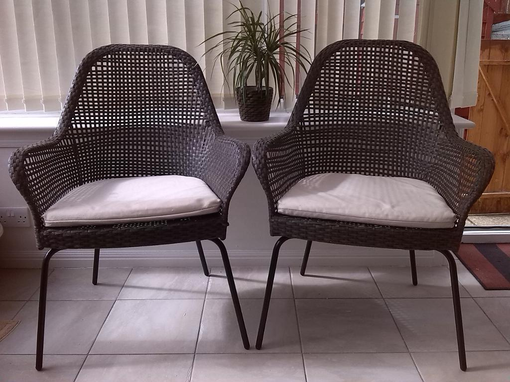 Two Ikea Ammero rattan armchairs with seat pads ideal