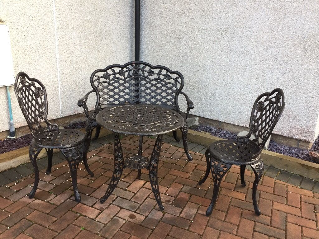 Wrought Iron Table And Chairs Garden Black Cast Iron Effect Table Chairs And Bench In