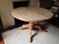 Antique pine round dining table, extends to oval, large