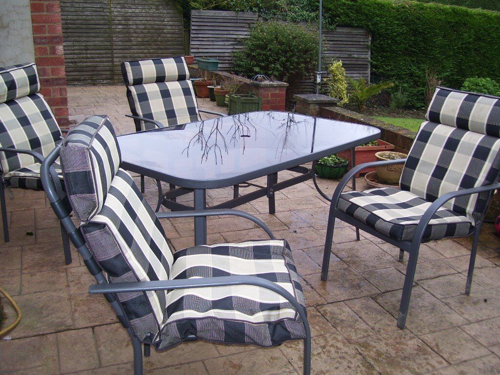 cast iron table and chairs gumtree ch07 lounge chair patio set garden glass top 150 x 90 cm + 6 stackable with cushions very good ...