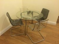 IKEA Salmi Glass Dining Table and 4 x Tobias Transparent ...