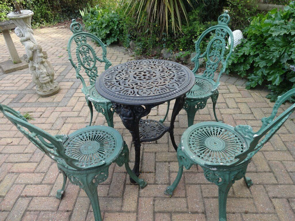 cast iron table and chairs gumtree tri fold beach chair garden furniture set 4