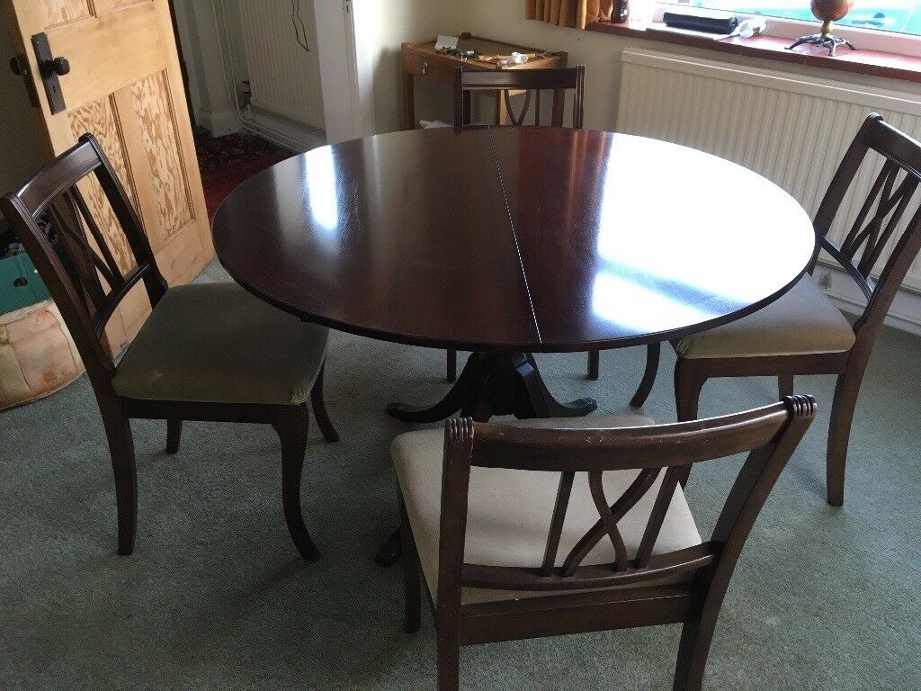 Polished Round Extendable Dining Table And Chairs FREE