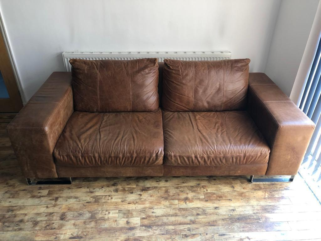 brown leather sofa on legs sectional recliner with cup holders in chocolate microfiber dfs 3 seater chrome modern design