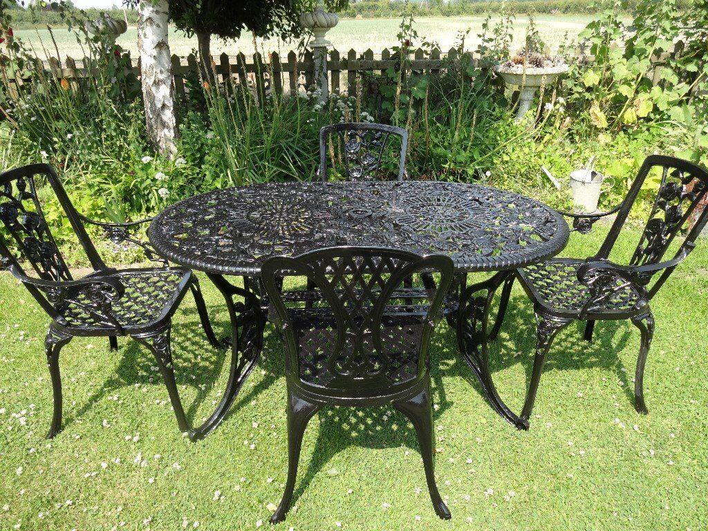 cast iron table and chairs gumtree wishbone chair replica aluminium garden set large 4