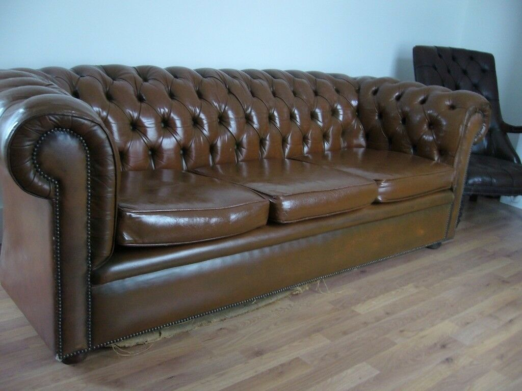 leather chesterfield sofa beige corner beds for small rooms antique brown tan settee button