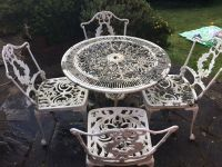 White metal garden table and chairs