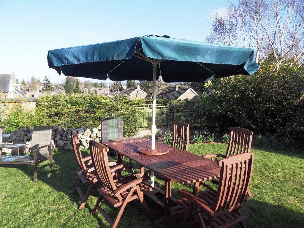 revolving chair gumtree cover express ann arbor wooden garden patio set 6 reclining chairs extending