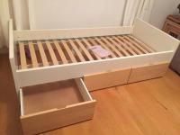 Ikea Brekke single bed frame with three wheeled underbed