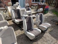 Camper van conversion swivel captain seats and sliding