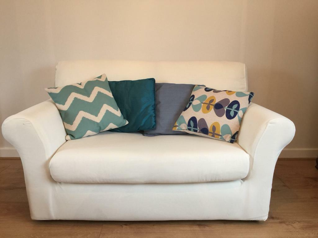 sofa upholsterers leicester light dark floors two seater with white stretch fitting cover in