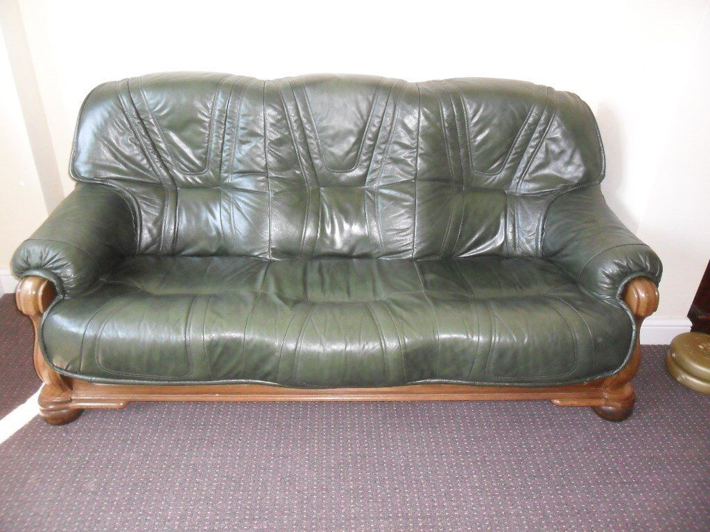 wood frame leather sofas how to keep cat off sofa 3 seater green settee with heavy solid oak