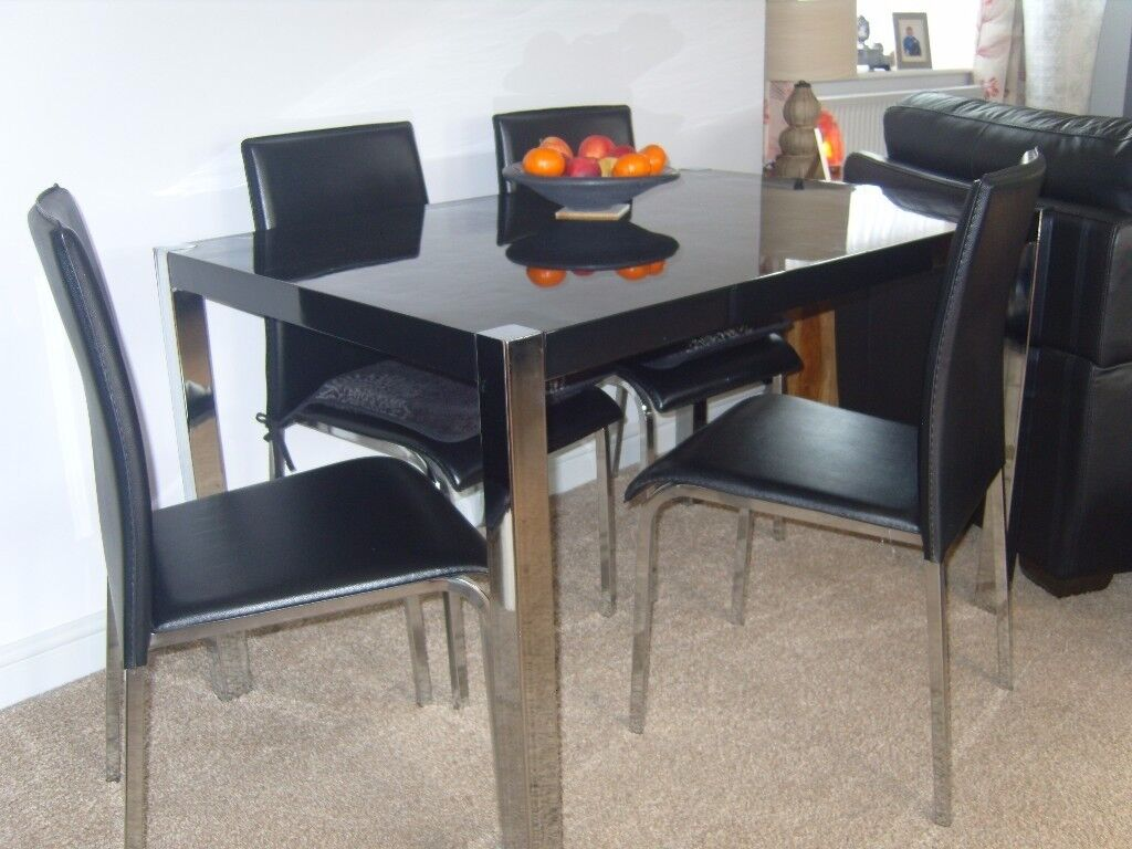 glass kitchen tables and chairs companies that spray paint cabinets black top dining table chrome legs 4