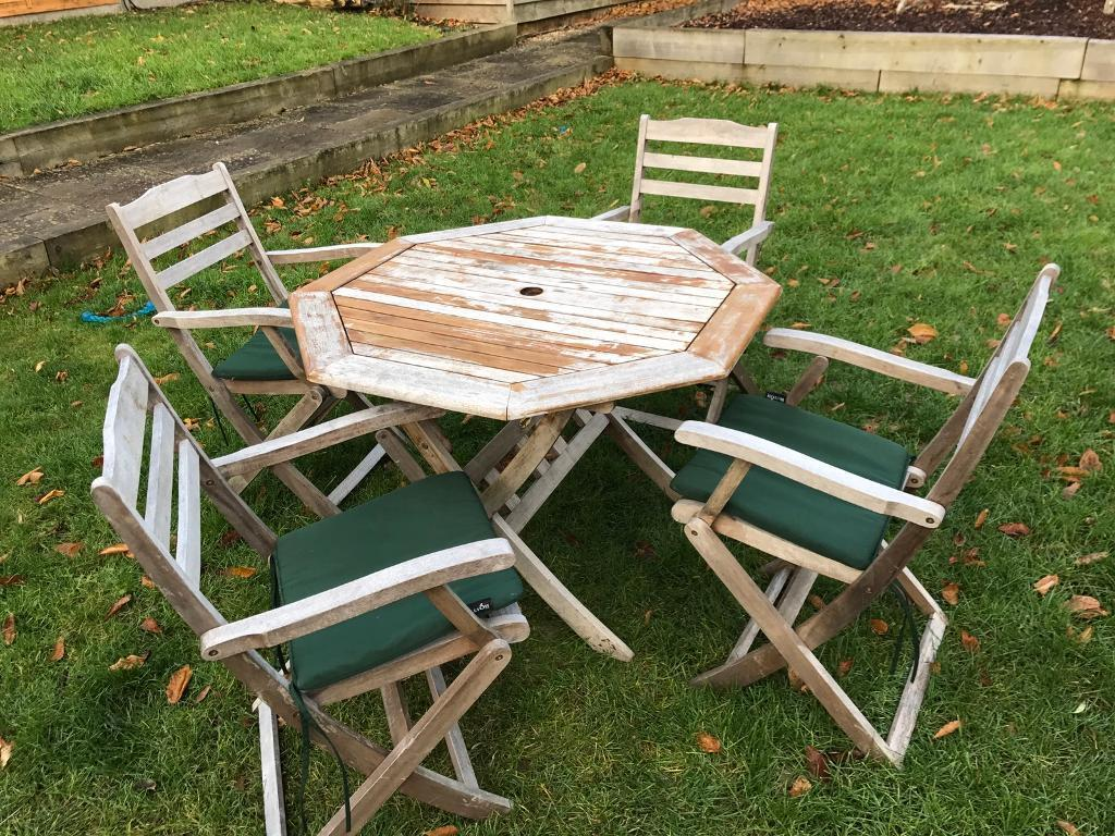 cast iron table and chairs gumtree ball for sale teak outdoor patio in harpenden