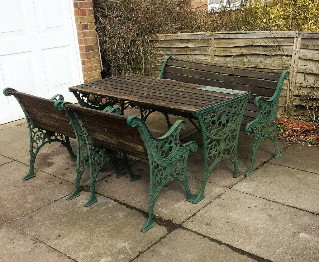 Cast iron and wood table  chair and bench patio garden