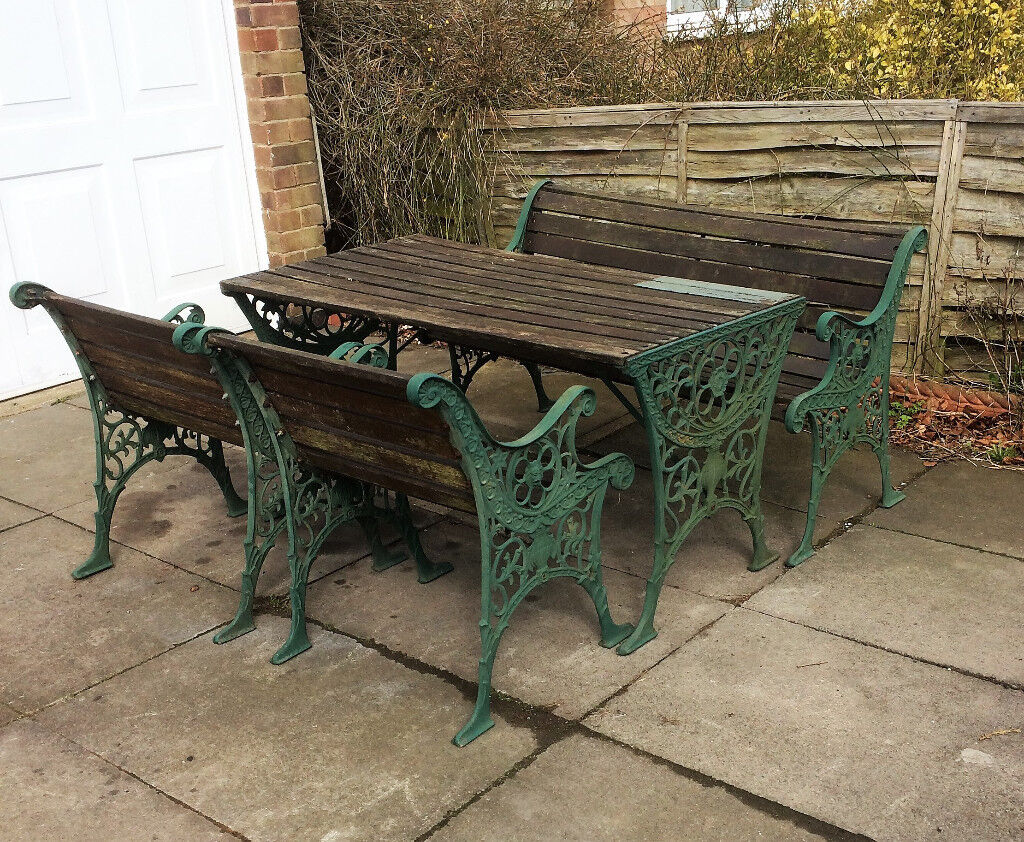 cast iron table and chairs gumtree swing chair covers argos wood bench patio garden