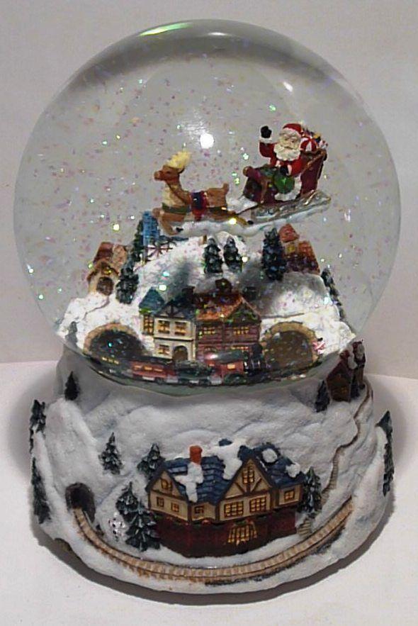 Schneekugel mit Spieluhr Glitzerkugel Santa mit Rentierschlitten + fahrender Zug