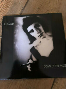 Down By The Water-PJ Harvey (Track 07).wmv - YouTube